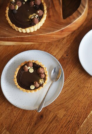 If you're looking to improve your pastry skills, see our Pâtisserie workshop. You'll make these delicious chocolate and hazelnut tarts, along with raspberry eclairs.