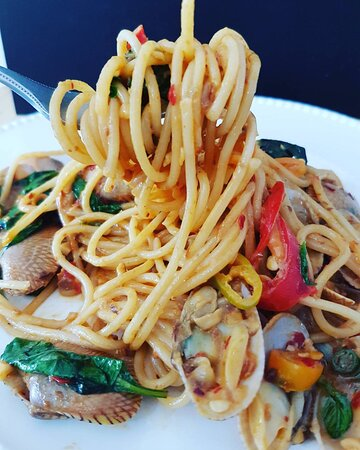 Spaghetti  with clams, roasted chili paste and sweet basil