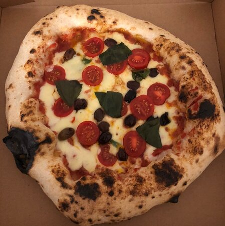 Margherita with garlic, cherry tomatoes, fresh chilli and olives.