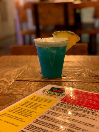 Blue Hawaiian, $10. Tasted fine, but the tiny, flimsy, plastic cup was a bit off-putting. Oh what a difference a clean piece of glassware could have made.