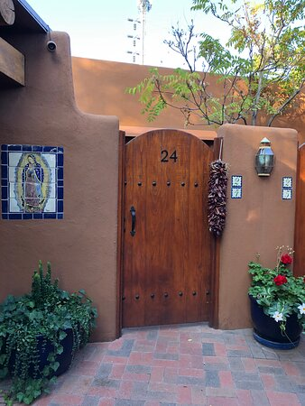 Private entrance with small patio area into our room.