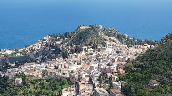 #Taormina from road to Castelmola. In the photo is possible to see the greek theater on the top and the city among the two peaks. The other peak is that of Saracen Castle  in Madonna Rocca. In the photo is in the right.