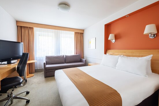 Enjoy a large sofa bed and double bed in our hotel room