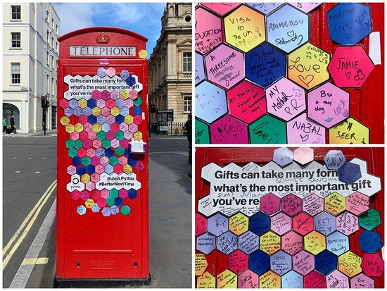 The neighbourhood of Marylebone, in central London: a colourful phone box at the southern end of Marylebone High Street