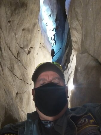 Warrior, AL: The light behind me is the guides flashlight; we were somewhere around 700 ft below the top of the mountain within one of it's caverns. I'm not the best in tight places but most I fit fine and never did I have an issue.