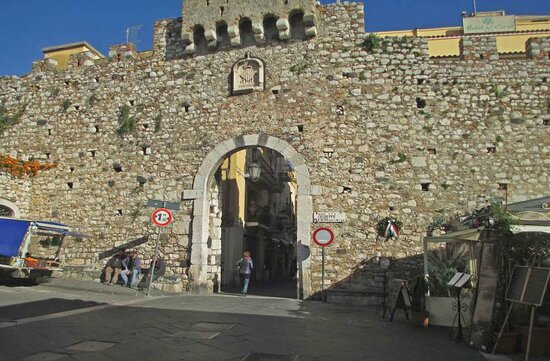 The door of second outside defensive wall of the medieval city of Taormina.  Today it represent the begin of Corso Umberto the main pedonal and touristic street of city.