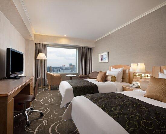 2 Single Beds Comfort Room