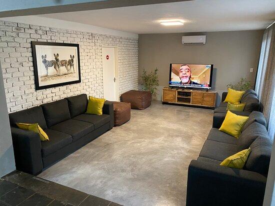 "Lounge with 64"" smart flatscreen TV"