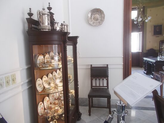 """Display of some beautiful dining utensils (in one of """"about 10 rooms"""" on the main level)"""