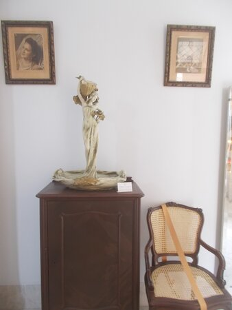 """The beautiful sculpture featuring a maiden or such (in one of """"about 10 rooms"""" on the main level)"""