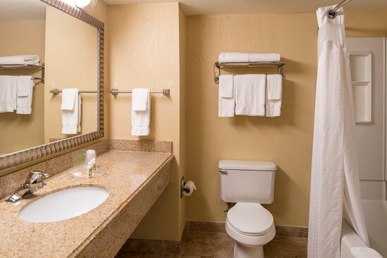 Bathroom with lots of counter space, Bath and Body Works products