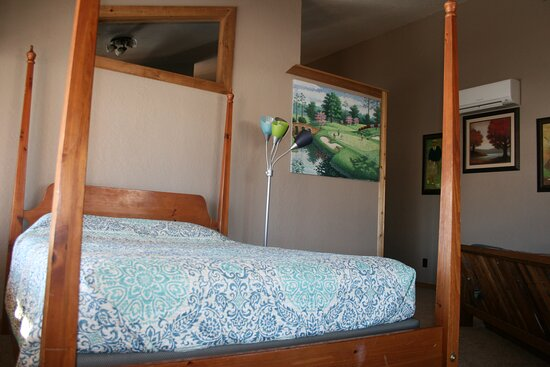One of the two queen beds in the Superior Lodge Suites