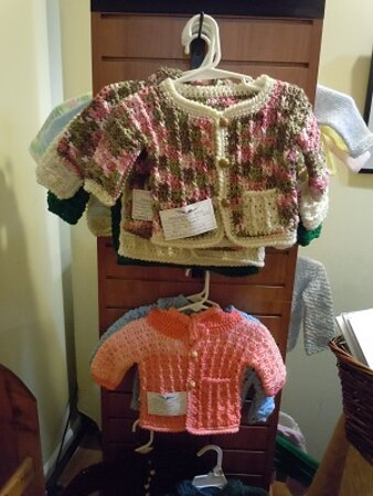 Hertford, NC: The gallery has baby sweaters knitted and crocheted by local artisans.
