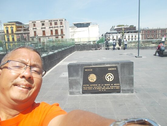 """Just beside the """"ruin site"""" on the Plaza's northeast corner (with also the UNESCO heritage sign as seen behind me)"""