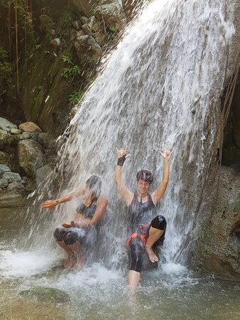Me and my friend feeling the force of one of the waterfalls
