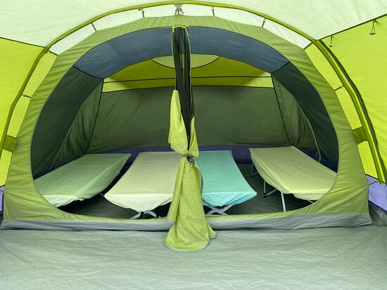 Pre-pitched tents come with camp beds, table and chairs