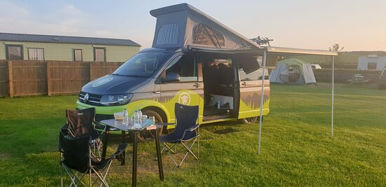 It only takes a few minutes to set up once you have chosen your pitch. All our Herdy Campervans have a table and two chairs, plus pots and pans, knives and forks.