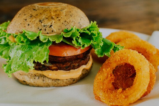 Veggieburger de la Montaña with a choice of homemade bun, vegannaise and side of salad, onion rings or fries.