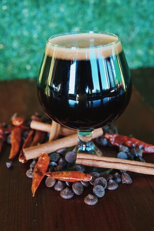 Barrel Aged Mexican Stout Mexican Stout - 11.6% ABV Four types of Chilies, Chocolate and notes of Cinnamon.