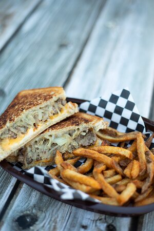 The MOB Patty Melt Basket OUR TAKE ON A CLASSIC: PROVOLONE, HAVARTI & AMERICAN CHEESES ON RUSTIC SOURDOUGH BREAD WITH 1/3LB OF DAILY FRESH GROUND SELECT CUTS OF BEEF & MOB'S MARINATED GRILLED ONIONS with hand cut fries
