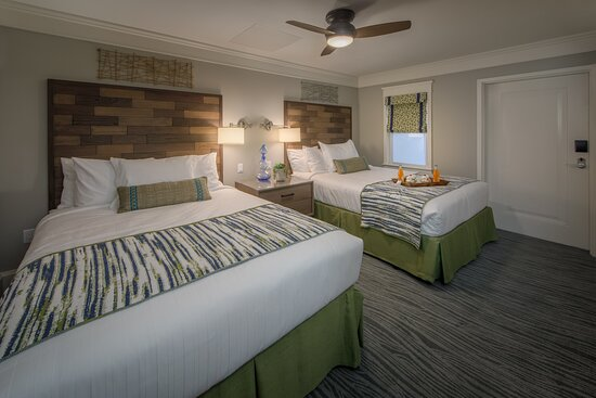 Comfortable queen beds in Signature Collection villa
