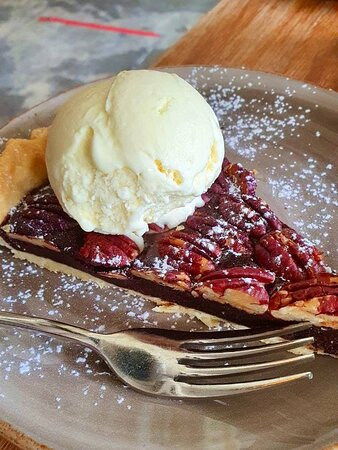 A slice of pecan pie with vanilla ice cream. The chocolate filling below the layer of pecans was slightly chewy and had a hint of cinnamon. The crust at the bottom was not soggy at all, and was in fact, buttery and flakey. I quite enjoyed this dessert!