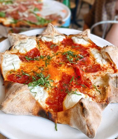 Star Luca - Star shaped pizza filled with ricotta cheese, spicy salami, mozzarella, Italian tomato sauce and basil