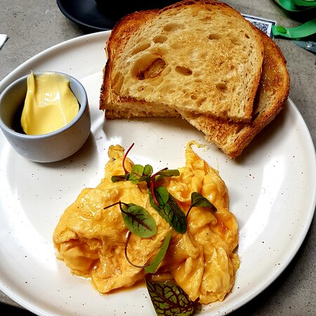Delicious scrambled eggs on toast