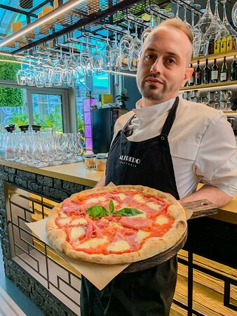 Our chef with pizza