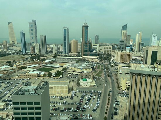 Dasman, Kuwait: View towards the North and NNW part of Kuwait City with Kuwait Bay beyond. (The tall cream colored building at the far left is the Central Bank of Kuwait tower)