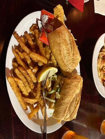 Catfish Po-Boy with incredible crispy fries.