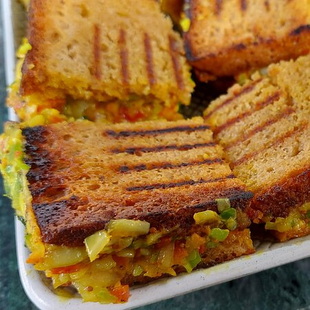 Our Famous Bombay Masala with Cheese Sandwich, made with freshly made Wheat Flour Bread.