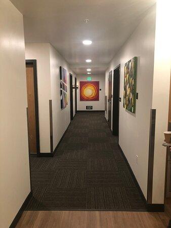 Hallway with original art on the walls