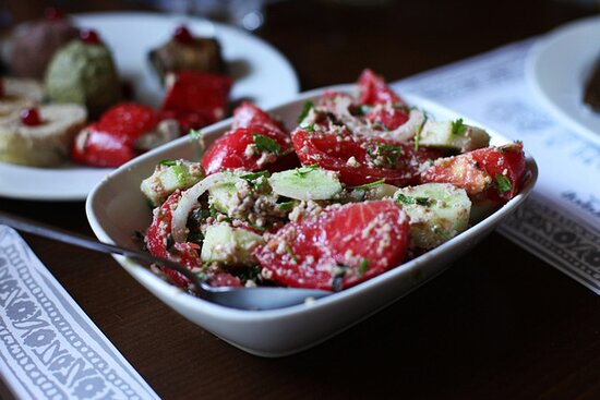 5-Day Holiday Package in Georgia: Tomato and cucumber salad with walnut sauce. must-try vegetarian dish.