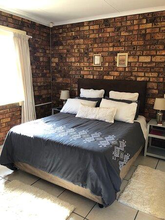 Queen size bed in room 5