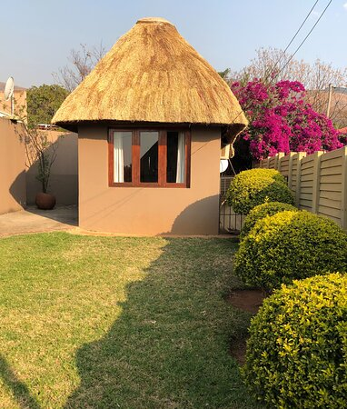 View on room 2 with thatched roof and private entrance.