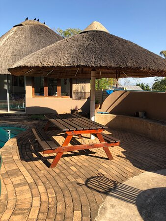 View on the braai  area next to the pool.  Kitchenette in background.