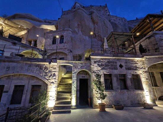 Hera Cave Suites at night.