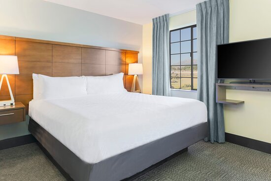 Unwind in our King sized bed with plush linens and pillows.