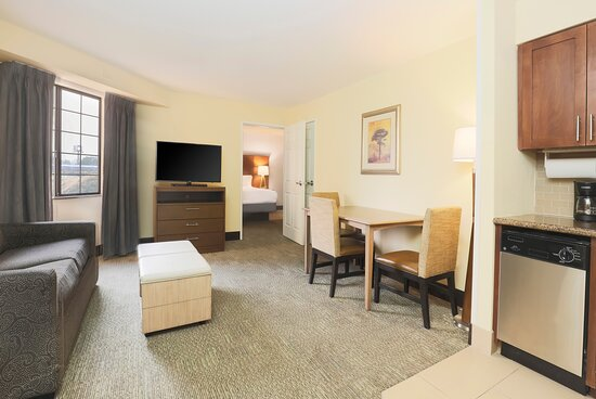 Our Two-Bedroom Suite features a full kitchen and dining table.