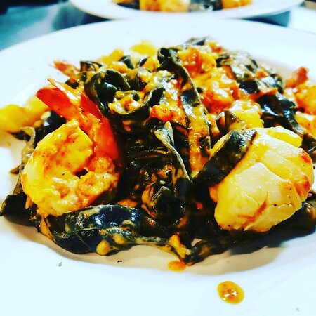 Squid Ink Fettuccine with shrimp and crab in a rose sauce