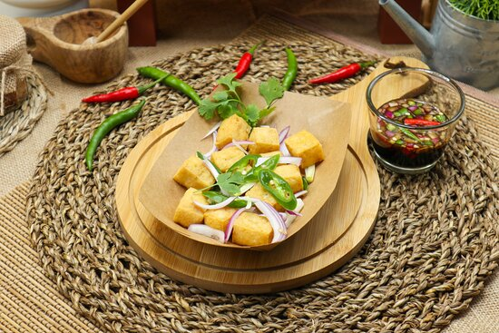 Tofu Bites - Deep-fried tofu served with a mixture of soy sauce and vinegar, chopped onions, scallions and red chili peppers.
