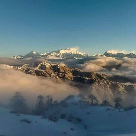 Mt.Kunchenjunga dominating the skyline,Visual seen from Sandakphu-Phalut hilltop WB    Explore Sikkim & Darjeeling ,   Contact us at +91-9910847599 easthighlandstours@gmail.com