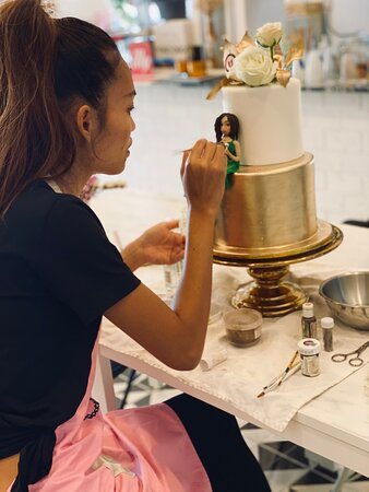 A study in concentration - Anne hand-painting a special birthday cake for @amanpuri -  #passion  - once again, big big thanks to the talented Numfon for her lifelike modeling  #phuket  #birthdaycake  # 3dcake  #phuketbakery