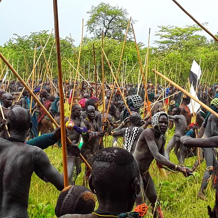 🌐 www.remoteomovalleytour.com  Ethiopia, #thelandoforigins🇪🇹🇪🇹🇪🇹   'Donga' or stick fight, is practiced by Suri and mursi tribes men at the end of each harvest. It combines combat with ritual and sport and aims to get young men used bloodshed-which Leaders believe comes in handy if they clash with other tribes. Before Donga some suri drink the fresh blood of their cattle .   #Visit#omovalley#omovalleytribes#photographytours#tripadvisor#mursi#Dorze#hamer#suri#Dassench#Nyangatom#Ari#Bena#