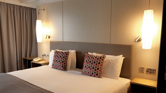 Bright and spacious bedroom with free Wi-Fi and toiletries