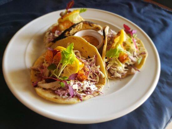 Shrimp tacos Homemade flour tortillas served with Mahi fish, shrimp or combo, fresh raw salad, corn tortilla chips and chipotle salsa.