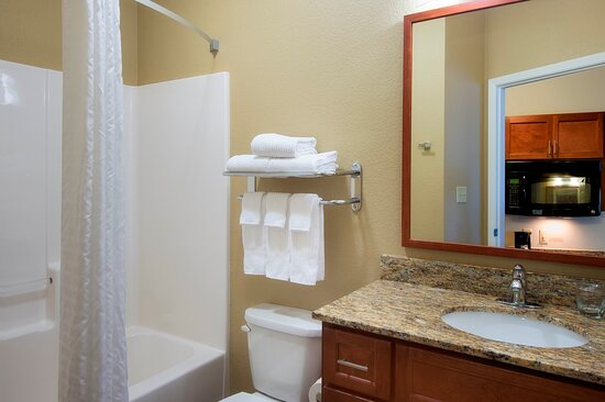 Guest Bathroom featuring granite counter tops