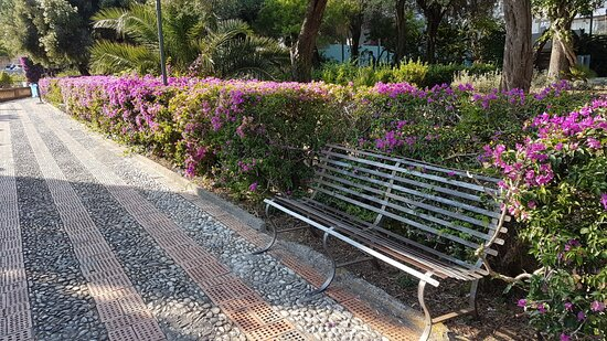 Taormina, Italy: One of many benches from where you can enjoy by Etna valley overview
