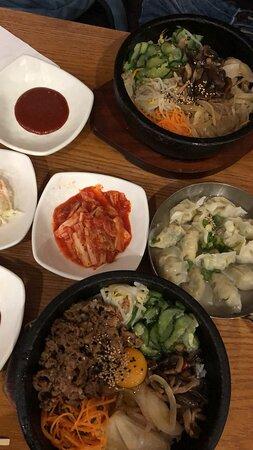 2 Bibimbaps, dumplings, and kimchi